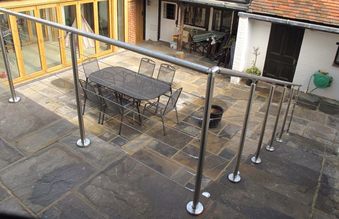 Stainless steel balustrade and handrails with wire infill